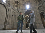 FILE- In this Friday, April 8, 2011 file photo, Canadian tourist David Froud, left, and his Iranian wife Mahnaz sightsee the Jomeh mosque, which is now a historical monument, in the city of Isfahan, some 234 miles (390 kilometer) south of the capital Tehran, Iran. A U.S. luxury tour company is offering a new destination that¿s sure to raise eyebrows: Iran. Those at Abercrombie & Kent say the tour is perfectly timed as Iran is opening up after the nuclear deal with world powers. However, the U.S. State Department has issued strong warnings about Americans traveling to the Islamic Republic as hard-liners have been arresting people with connections to the West.(AP Photo/Vahid Salemi, File)