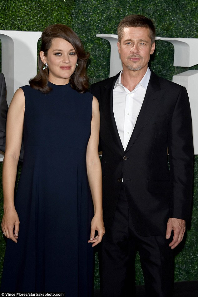 Reunited: Despite being dragged into his messy divorce, Marion supported Brad Pitt (right) as he made his return to the limelight