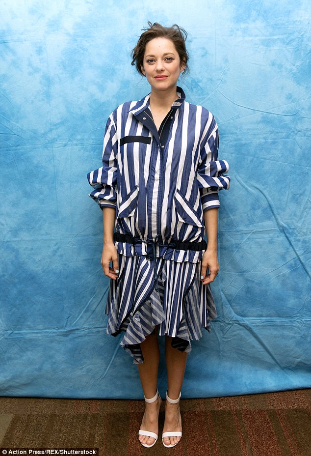 On point: Marion wore stripes for her photocall appearance earlier that day