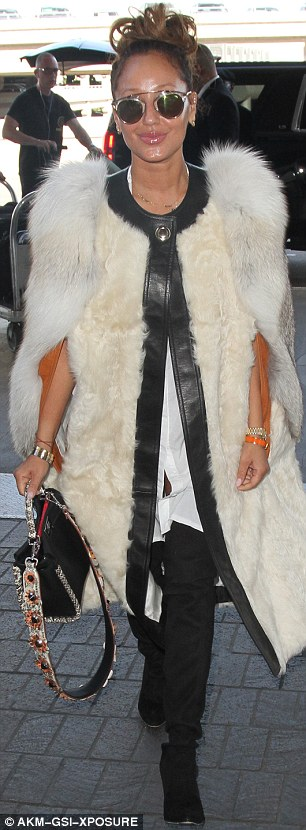 Fur goodness sake: She was wearing this heavy jacket on a sweltering California day