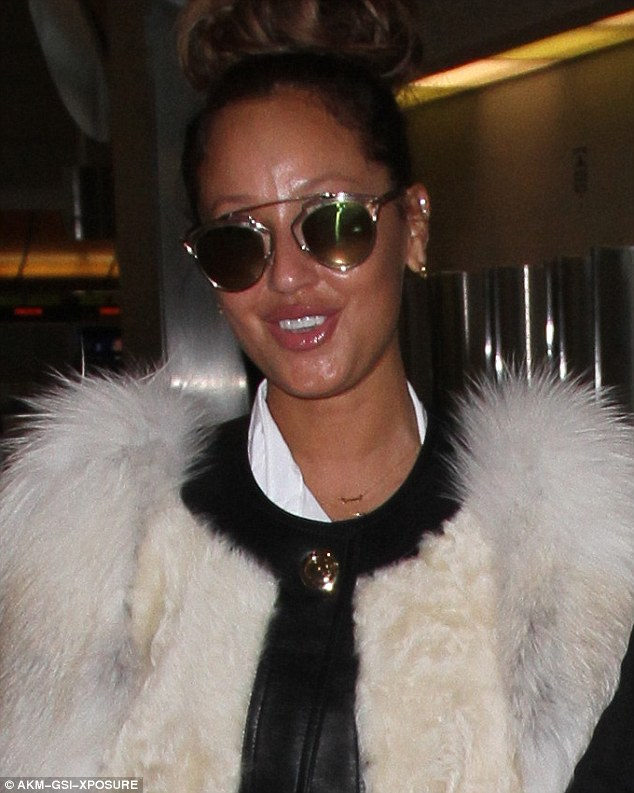 Shady lady: The self-styled singer wore a pair of ostentatious sunglasses