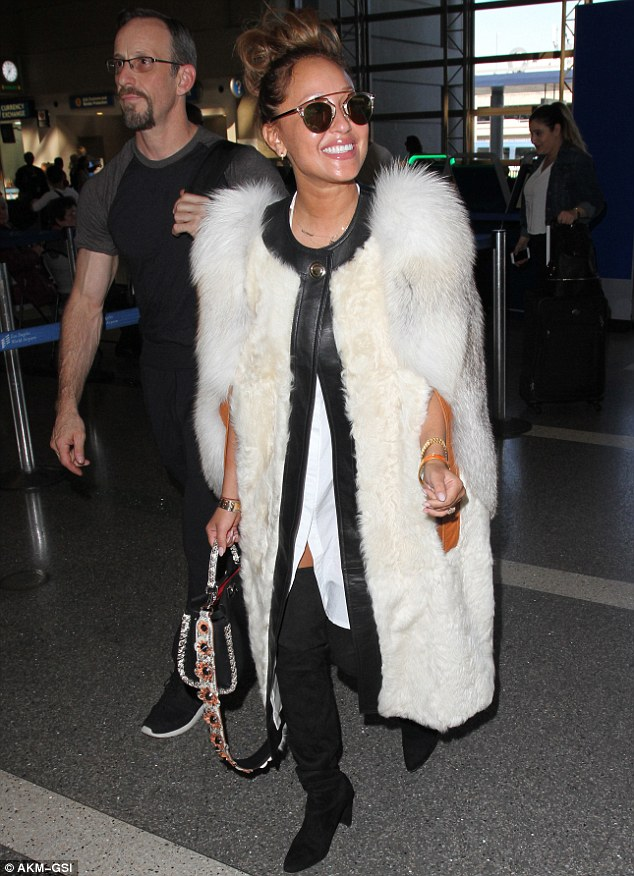 She looks reLAXed: She seemed full of beans as she headed through the departure lounge
