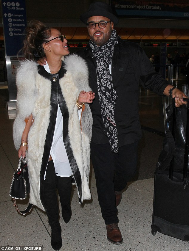 So in love:Adrienne Bailon was all smiles as she jetted out of LA with her Christian musician other half Israel Houghton on Wednesday