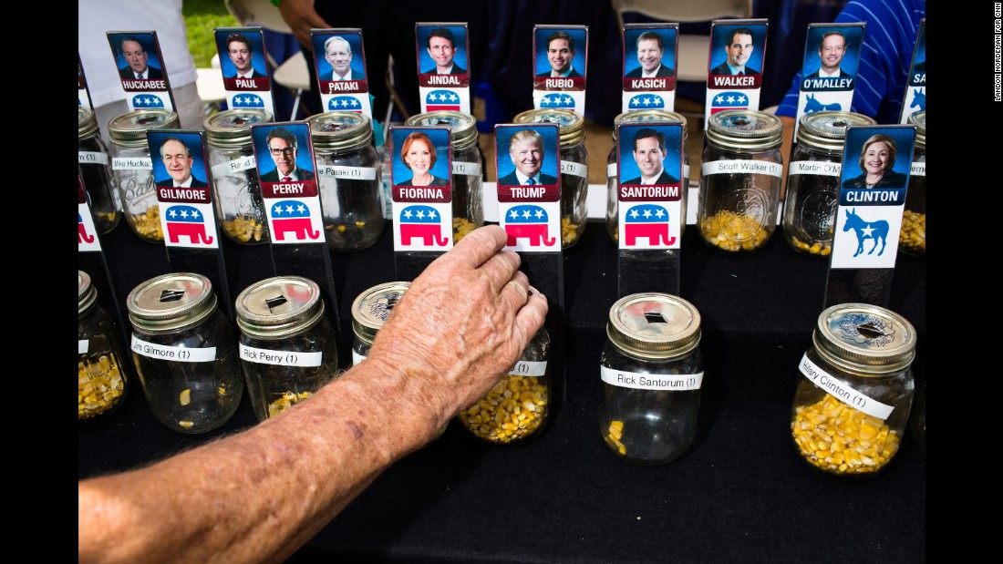 "People at <a href=""http://www.cnn.com/2015/08/15/politics/gallery/iowa-state-fair-postcards/index.html"" target=""_blank"">the Iowa State Fair</a> use corn kernels to show support for their favorite presidential candidates on August 13, 2015. Many candidates attended the fair, mingling with voters in the first-in-the-nation caucus state."
