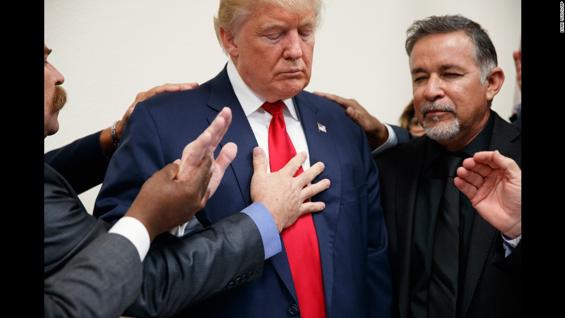 Pastors pray with Trump during the Republican nominee's visit to Las Vegas on October 5, 2016.