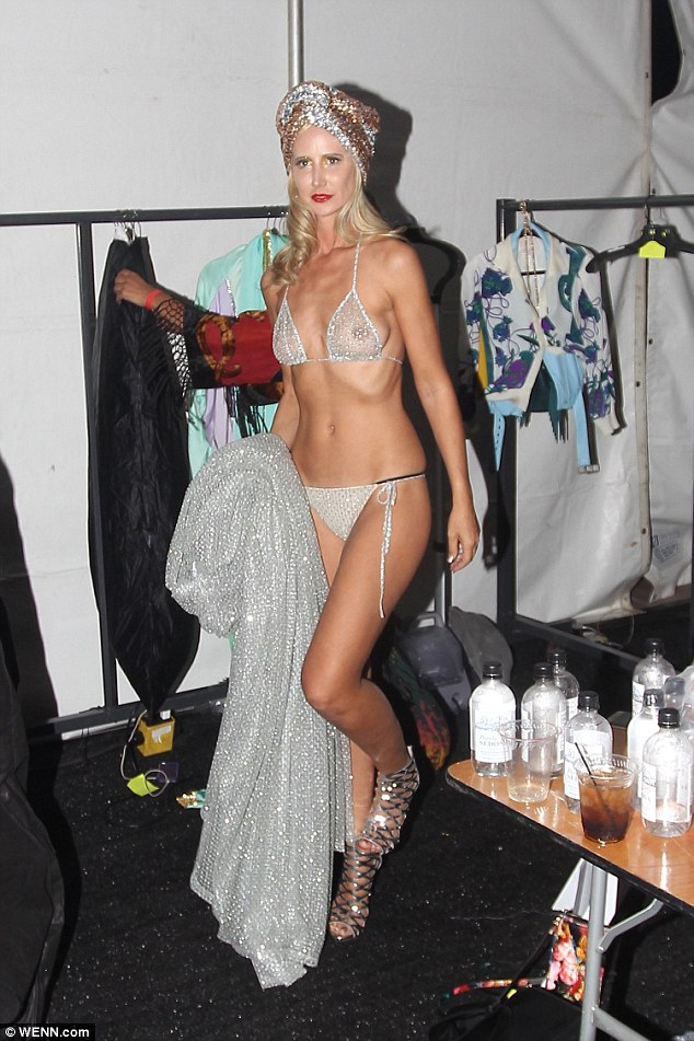 Forever young: Lady Victoria Hervey, 40, looked half her age as she showed off her incredible figure in sheer silver lingerie at the Palms Springs Fashion Show in California on Thursday