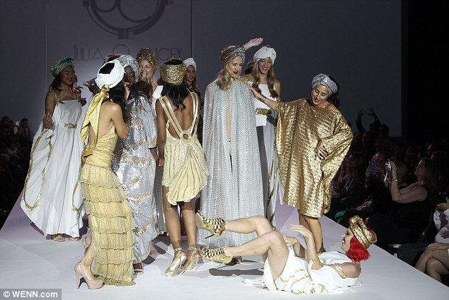 Rolling on the floor laughing: Lady Victoria joined the other models on the runway