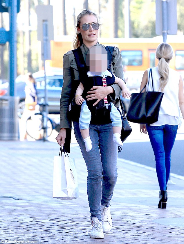 Cool cat: Cat Deeley seems to have taken to motherhood with aplomb as the British TV presenter headed out with baby Milo on Wednesday