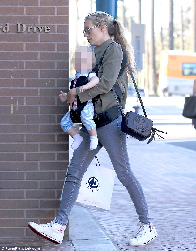 Chic mummy: The 40-year-old star looked the picture of relaxed confidence as she took a trip to the shops in Los Angeles with her 11-month-old son