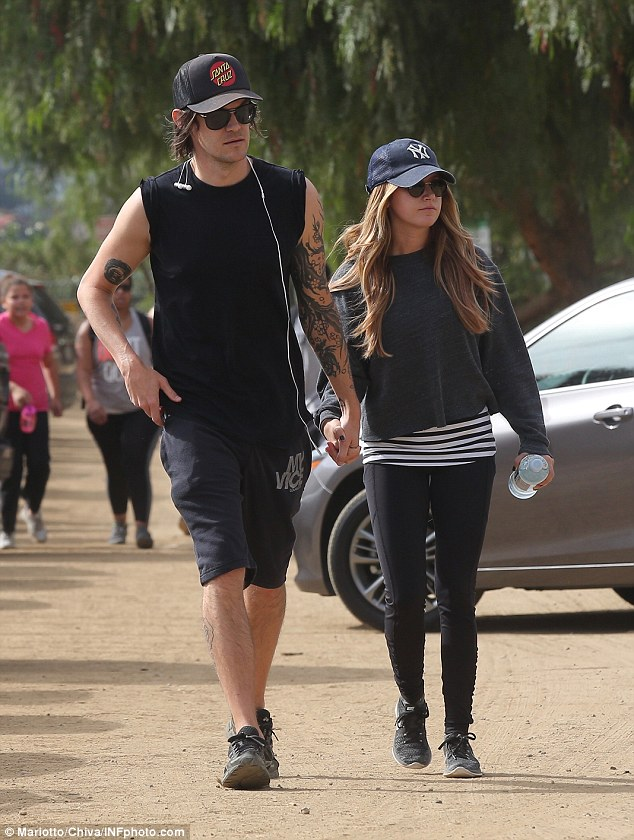 Hiking gear: The actress, 31,wore athletic leggings and a dark sweater over a stripy top while the musician, 34,was dressed in baggy shorts and a tank top that showed off his arm tattoos