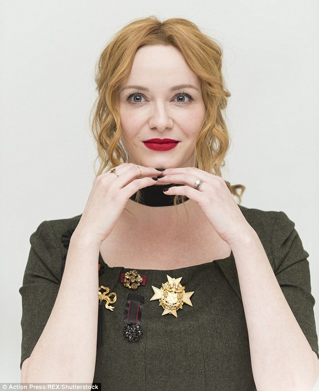 Tendrils: The 41-year-old redhead rocked a trendy black choker with a curly updo and red lipstick for the sit-down event