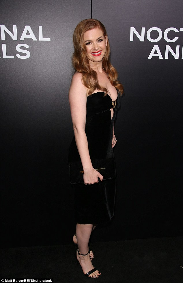 Fab: The 40-year-old matching it with a dainty pair of black ankle-strap heels and a black clutch purse