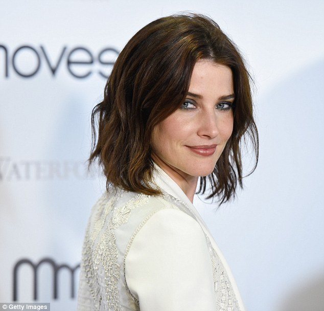 Sassy: Her wavy brunette locks were cropped at the shoulder and parted in the middle