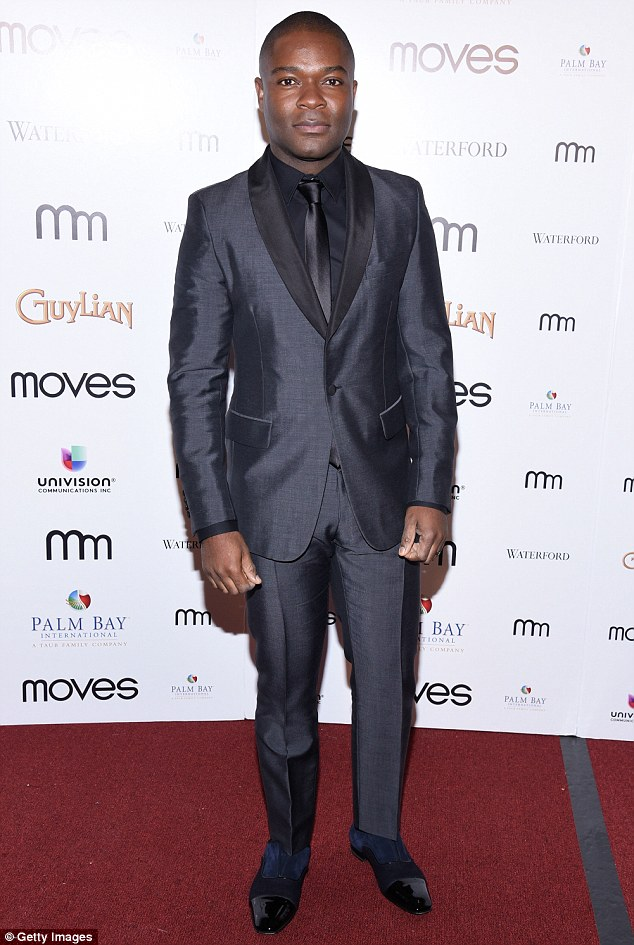 Shiny shoes: Selma actor David Oyelowo, 40, also looked quite dashing in a shimmery black suit and tie combination