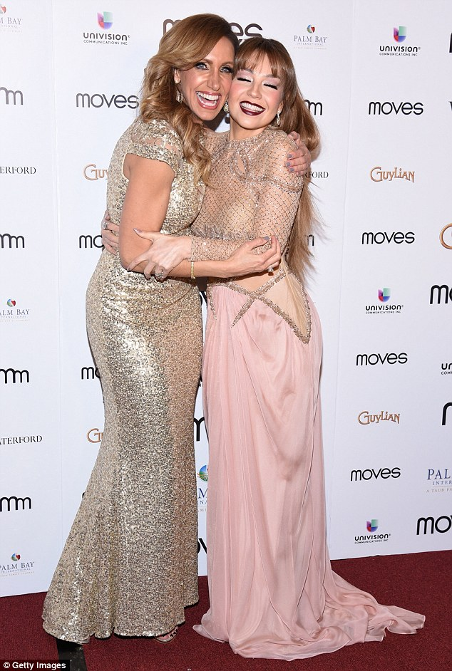 Glitter girl: Cuban model and television personality Lili Estefan (left), 49, definitely caught some glances with her own floor length metallic dress