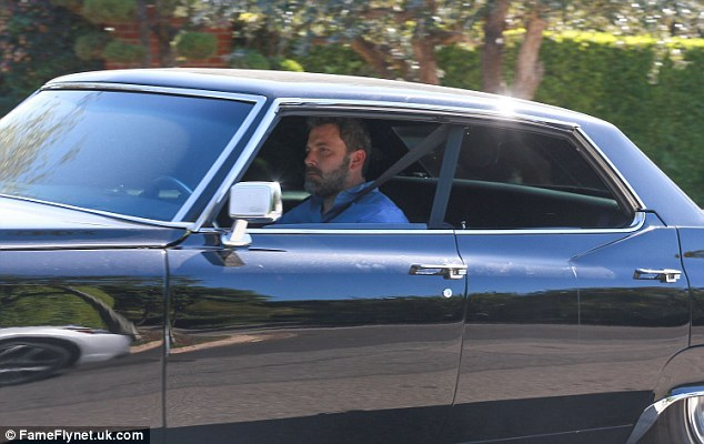 Ben-mobile: Jen's estranged husband Ben Affleck was snapped driving a black Cadillac in nearby Brentwood, California