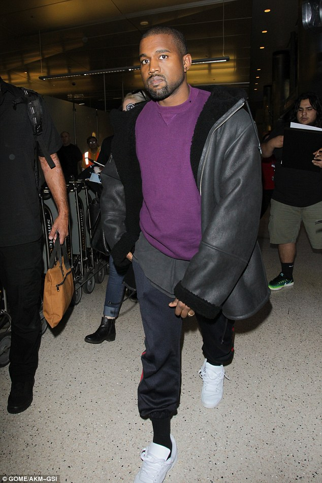 Staying hot:on Friday Kanye West decided to bundle up in multiple layers for his flight out of the City of Angels