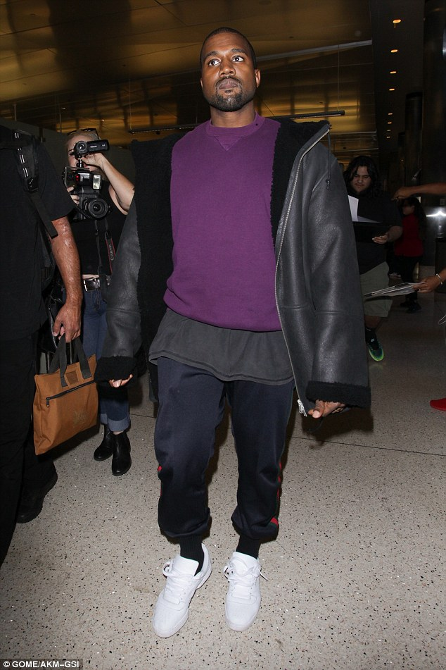 Variety: The 39-year-old hip hop artist may have been headed somewhere chilly, as he sported a black fleece-lined leather jacket over a dark purple pullover
