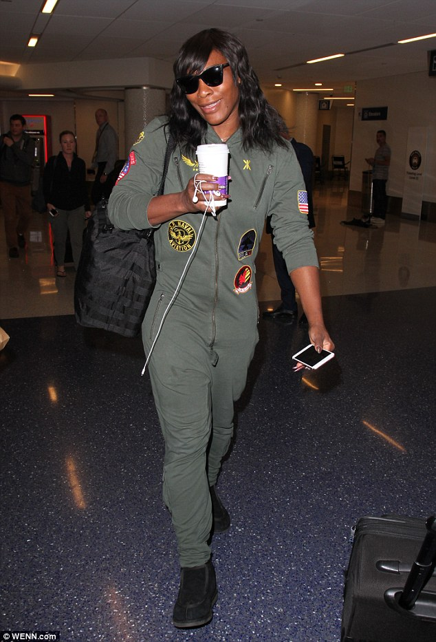 Chill mode: The 35-year-old professional athlete looked comfortable in the quirky look as she made her way through the Los Angeles international travel hub