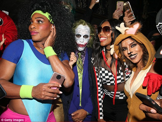 Shy for the cameras? Serena and Lewis - dressed in the Joker costume - were spotted at Heidi Klum's Halloween bash