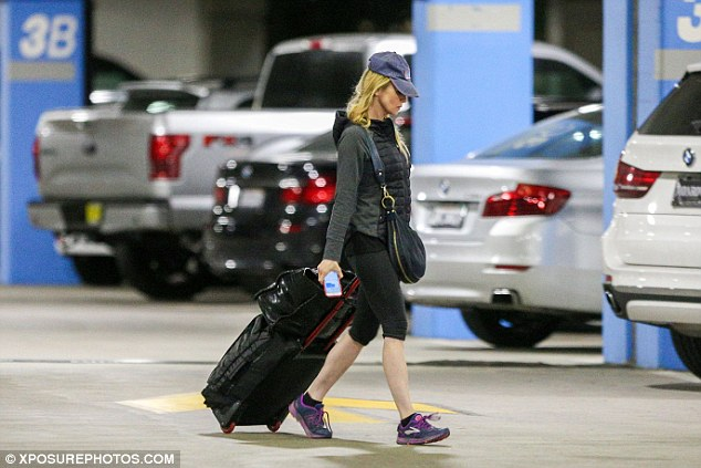 Used to this: A seasoned traveller, the Bridget Jones's Diary star had her suitcase, carry on, and purse neatly packed and ready for take off