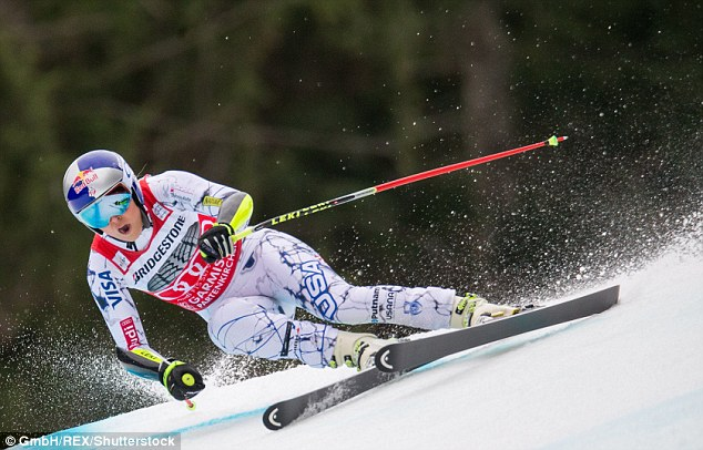 Doing what she does best: Lindsey - pictured during a race in Germany back in February - revealed the injury occured during a crash in Copper Mountain, Colorado