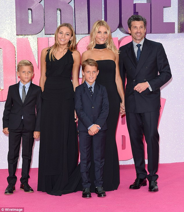 Better together: The couple made their first red carpet appearance as a family since calling off the divorce in September, and they looked happier than ever