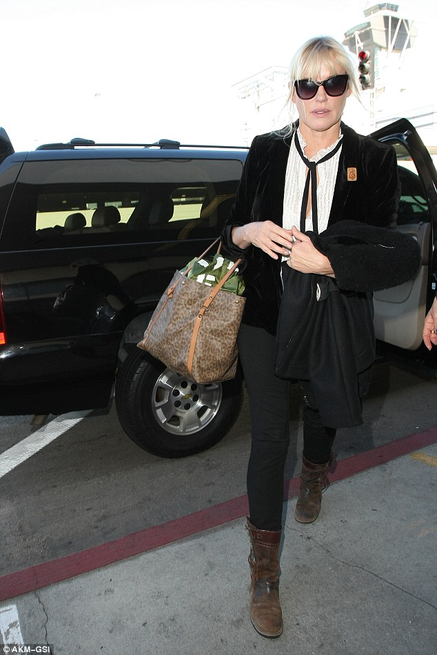 Cute couple: Daryl  arrived at LAX on Thursday looking in battered biker boots
