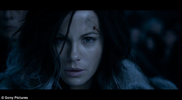 She means business: As the trailer continues Kate comes into her own as her warrior character, wielding her own gun and powerfully kicking down her enemies