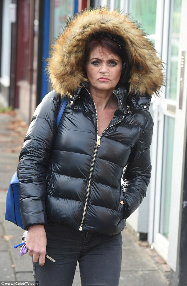 The dark side: Danniella Westbrook showed off her new hairdo but still sported a plaster on her nose on Friday in Liverpool