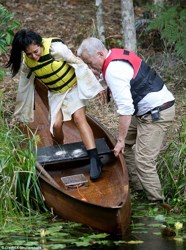Careful! Scarlett, who was still clad in a pretty white dress and had never canoed before, looked apprehensive as she awkwardly lowered herself into the boat