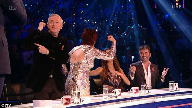 Having a laugh: Sharon and Louis quickly got to their feet to emulate his pose while Dermot cheekily observed: 'Looking a little Honey G there aren't we?
