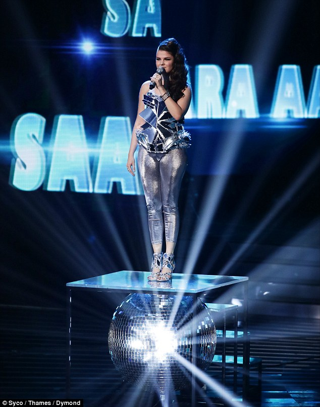 Dressed to kill: The Finnish star wore a sexy, silver metallic dress and spared no expense with her powerful rendition