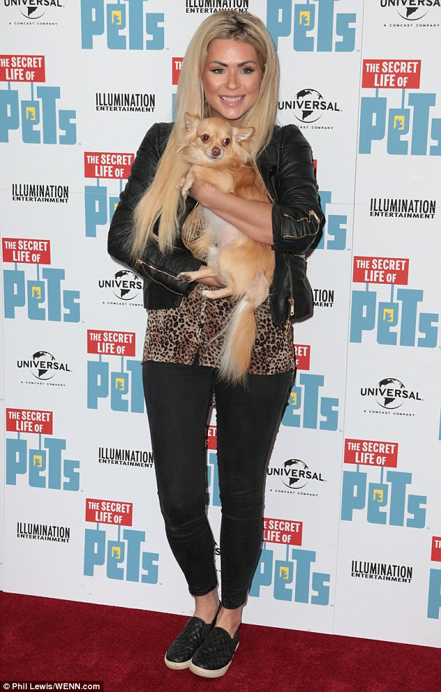 Puppy love: Nicola McLean, 35, was in good spirits as she brought her children and adorable pet pooch to the UK premiere of The Secret Life of Pets DVD launch in London on Saturday