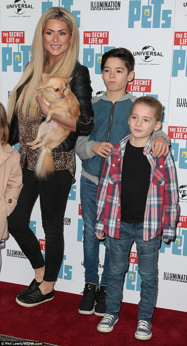 Happy families: Nicola was not joined on the red carpet by her husband, ex-footballer Tom Williams, but had plenty of company in the form of their two sons, Rocky, 10, and Striker, six