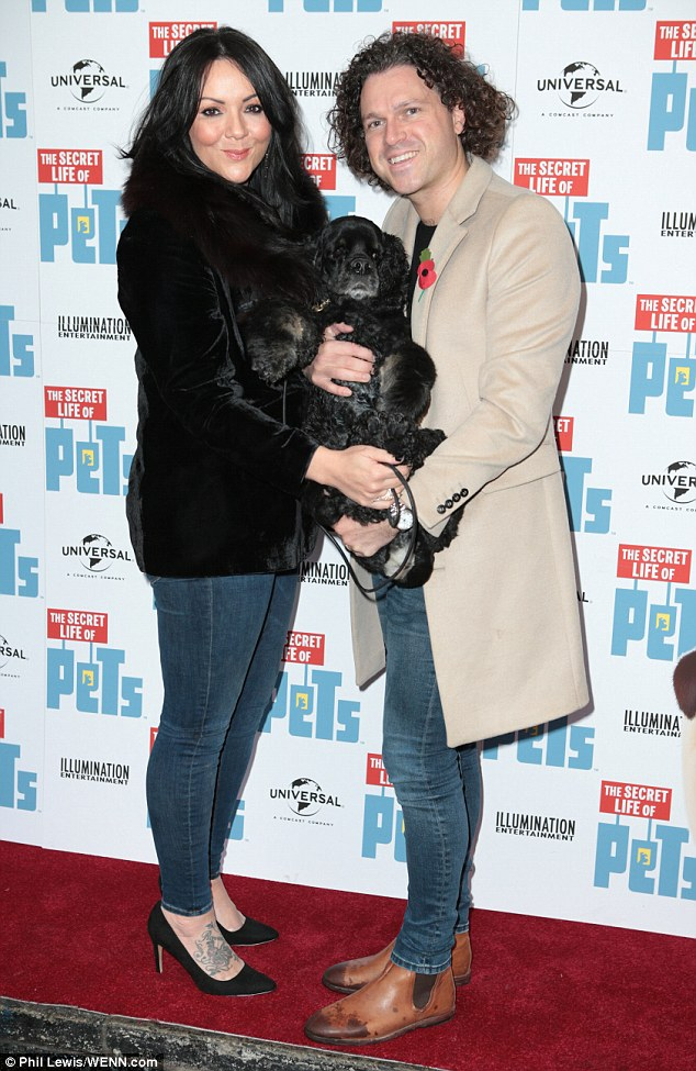 Puppy love: Martine McCutcheon, 40, looked happily loved-up with her husband Jack McManus as they attended the UK premiere of The Secret Life of Pets in London on Saturday