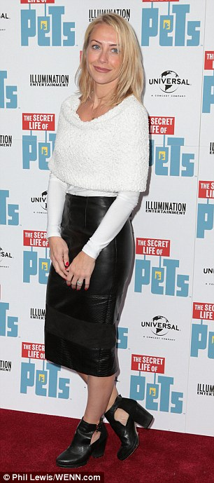 Pooch pals: TV presenter Laura Hamilton let her outfit steal the attention in a sexy leather pencil skirt