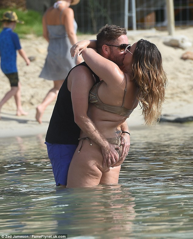 Beach babe:Chanelle Hayes looked more confident than ever as she soaked up the sun in a tiny brown bikini on her recent break to Ibiza with boyfriendRyan Oates