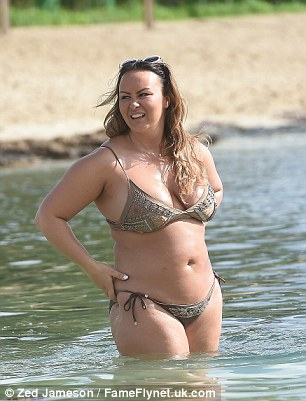 Loving life:Chanelle, who has spoken at length about how much she loves her new fuller figure, paraded her sexy curves around the beach in her scanty two-piece
