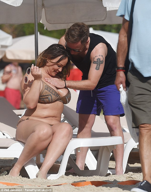 Saucy: Ryan seemed to be having a lot of fun applying some suncream on his girlfriend