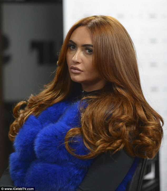 Mane attraction: The Ex On The Beach star made a statement in an electric blue faux-fur gilet as she got her new do blow-dried to perfection
