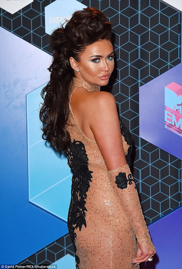 Before: Her locks were previously a dark chocolate shade (Pictured at last weeks MTV EMAs)