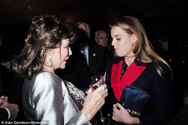 Life and soul: Dame Joan Collins chats to fellow guest Princess Beatrice at Sir David Tang's