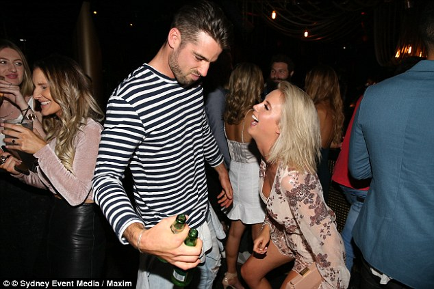 Get low! Olivia flaunted her enviable figure on the dance floor with Sam, as he held two beers in his right hand