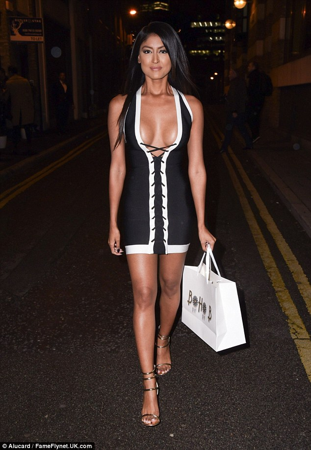 Racy lady: Ex On The Beach's Farrah Sattaur didn't let the bitter London chill get to her in a clingy mini-dress which flaunted her bust front