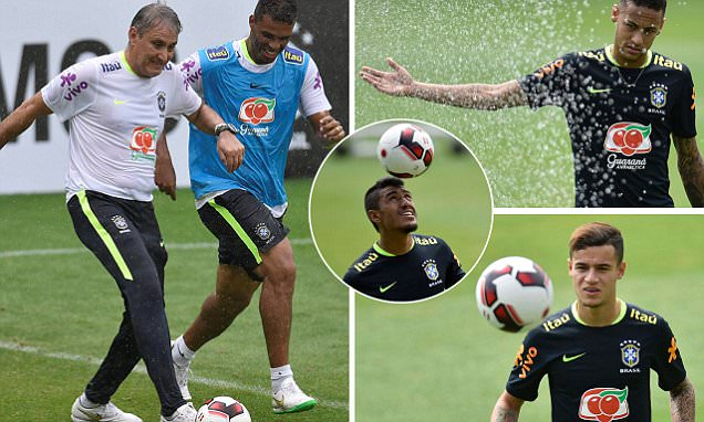 Brazil manager Tite shows his samba stars Neymar and Philippe Coutinho just how it's done