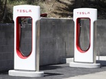 FILE - This undated file photo shows Tesla Motors charging stations neat Truckee, Calif.  Electric car maker Tesla Motors says it will end free use of its worldwide charging station network. The company says cars ordered after Jan. 1, 2017 will get roughly 1,000 miles worth of credits at the supercharging stations. After credits are used, owners will have to pay fees. Cars ordered or sold on or before Jan. 1 would still get free charging.  (Margaret Moran/Sierra Sun via AP, File)