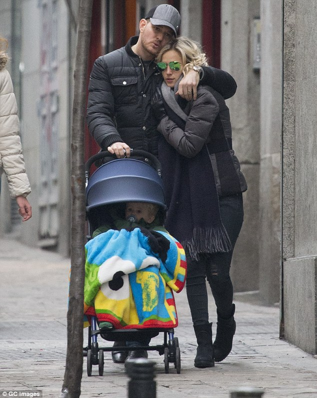Bublé and his wife Luisana, right were spotted strolling through Madrid with Noah in 2015
