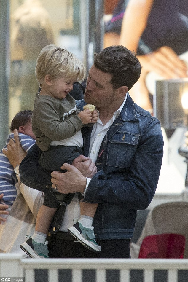 Family first: Michael Buble, 41, has reportedly vowed to stop singing to focus all his attention on his the liver cancer treatment of his Noah, three (pictured in Madrid last year)