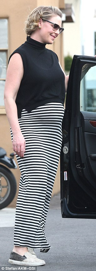 Sophisticated: The mom-to-be wore a figure-hugging, black and white striped maxi dress that highlighted her growing bump